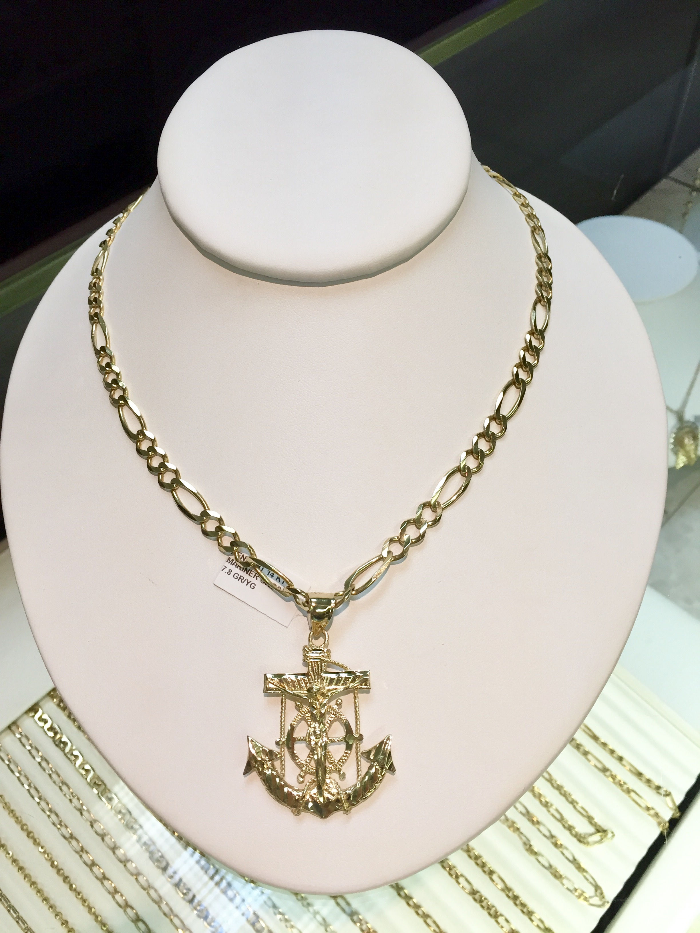 Gold chain and gold cross in our Kansas City jewelry store